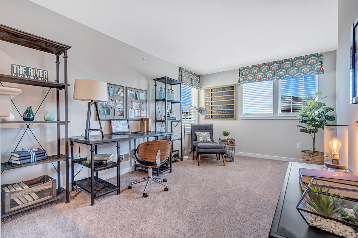 Office set up in a carpeted room at the River Links apartments.